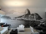 Photo of Rio, covering one wall of the living room for you to remember how the Rio is beautiful!