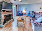 Cozy up next to the fireplace in this charming living room
