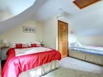 Family bedroom, includes a double bed and single bed, wardrobes and chest of drawers