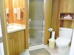 Comfortable, roomy  bathroom with nice walk-in shower, plenty of linens, & large jacuzzi bath tub.