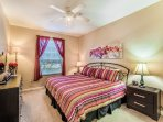Master bedroom with king bed and adjoining bathroom.  Large walkin closet.