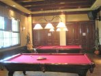 Play pool at the Players Club