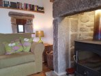 Cosy room with wood burner. Complimentary kindling and basket of wood supplied.