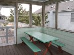 Screened in porch with picnic tables