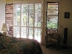 Master bedroom with king bed and Aloha Shutters