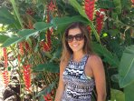 Our grandson's fiancée in front of Heliconia plant