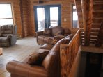Great Room; large sofa is a pull-out (hide-a-bed); doors to full length 40' deck