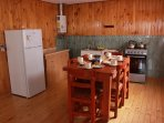 dishes , kitchen with oven, refrigerator , hot water 24 hours a day .