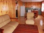 it has Wood Burning Slow Firewood , Comfortable sofas, LED TV Satellite , WI - FI