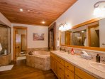 Master Bathroom with jetted tub, deluxe shower with multiple heads and jets, his and hers closets.