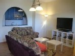 Cozy living room with a big flat tv, satelite, wifi, ...
