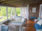 The porch is next. When you enter you look through big windows, through porch...