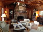 Entering living room from the right; can't  miss huge fieldstone fireplace
