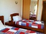 bedroom 2 single beds - lots of storage. balcony