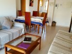 living room and dining area . 1 bed is a sofa bed. There is a TV, DVD player and wifi