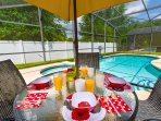Alfresco dining with glass topped patio table with parasol & 4 chairs