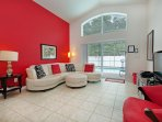 Family room with direct views and access to pool deck