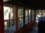 Full wall of windows overlooking the creek