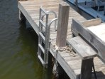 Lower Deck and dock with NEW SWIM LADDER. Fish Cleaner with water.  Behind, automatic Boat Sling