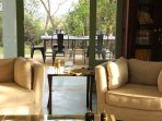 Teak Living room is open on all sides with views of Teak trees. The cross breeze is wonderful