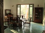 Indoor dinning room at the Teak Villa. With views of the teak trees open on all sides