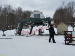 Community ski hill with its own lift and tubing run, a lodge with food and drinks, equipment rentals
