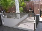 mesh sliding gate to keep infants safe from the steps