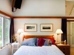 Master bedroom has queen bed and walk-in closet