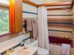 Upstairs bath, just outside bedroom door, has whirlpool bath and stereo speakers