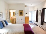 Spacious lower-level bedroom with shower bath, 10' ceilings and lots of wiindows