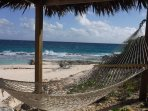 Hammocks await you at the thatched roof beach cabanas a few minute walk away