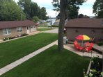 Partial view of Condo to the right with outside gas grill and a partial view of the Main Lake across