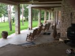 Very spacious and tranquil covered back porch with Jacuzzi tub.