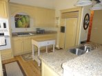 Fully furnished kitchen with eat-at bar.