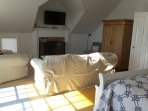 Master suite  TV and Fireplace.   Wood in back shed with beach toys