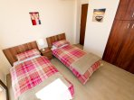 Ground floor twin bedroom with en suite shower room