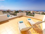 Sun bath with stunning sea views from the upper terrace