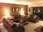 Large living room w/new furniture, plenty of seating & a Queen Pull-Out Sofabed.
