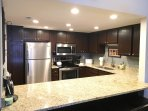 Fully stocked kitchen w/full-size appliances, pots, pans, blender, spices, etc.