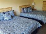 Upstair master en-suite with 2 queen beds