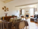 Relaxing and cosy living Room and dining area. AC, fans, reliable Wifi
