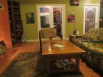 Comfortably furnished, living room has large view windows, satellite television and a sofa bed.