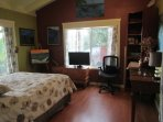 The 2nd bedroom has, cool ocean breezes,  queen bed,  desk and a TV which can be used as a monitor.