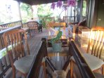 Covered back lanai is a great place to relax.  There is a B-B-Q and a large table for outdoor dining