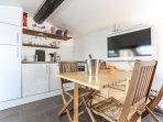 Modern kitchen with full-height fridge, full-size dishwasher, full-size oven and 4-burner stove.