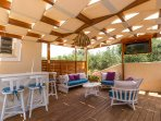 Great sitting area under the pergola, at the terrace!