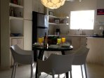 Magnificent Chandelier over a 4 seat dining set.