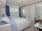 Bedroom 2 with comfortable twin beds, plenty of wardrobe space and views towards The Spinnaker Tower