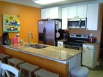 Stainless-steel appliances and granite counter tops
