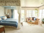 Feel like royalty in the master bedroom canopy bed with a sitting area and a fireplace